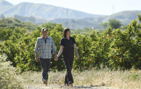"""This April 17, 2019 photo shows John Chester, left, and his wife Molly, of the documentary film """"The Biggest Little Farm,"""" at Apricot Lane Farms in Moorpark, Calif. (Photo by Chris Pizzello/Invision/AP)"""